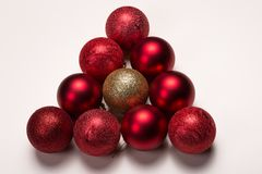Shiny red and gold decorative xmas balls on white. New year holidays Royalty Free Stock Photography