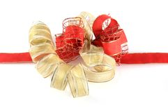 Shiny red and gold ribbon bow Stock Images