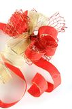 Shiny red and gold ribbon bow Stock Photo