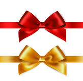 Shiny red and gold satin ribbon on white background Stock Photos