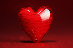 Shiny red heart background. Shiny red heart on glitter background Stock Photos