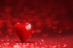 Shiny red heart background. Shiny red heart on glitter background Stock Photography