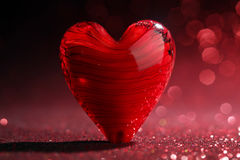 Shiny red heart background Stock Images