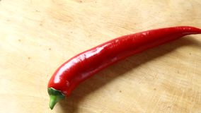 Shiny red hot pepper turning around stock footage
