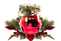 Shiny red jingle bell and holly sprig Stock Photo