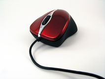 Shiny red optical mouse. View of a shiny red wired optical mouse Stock Photo