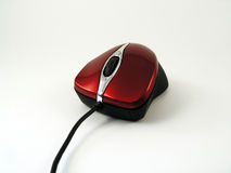 Shiny red optical mouse. View of a shiny red wired optical mouse Stock Images