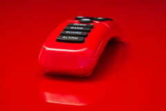 Shiny red plastic remote control Stock Photography