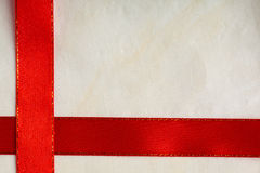 Shiny red ribbon stripe on bright cloth background. Stock Photos