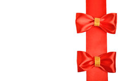Shiny red satin bows Stock Images