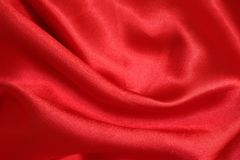Shiny red satin fabric texture. Shiny red satin fabric for background texture Royalty Free Stock Photography