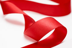 Shiny red satin ribbon Royalty Free Stock Image