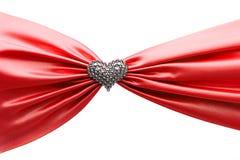 Shiny red satin ribbon and diamond heart. Shiny red satin ribbon and diamond heart on the white background Royalty Free Stock Photo