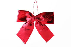 Shiny red satin ribbon on white Stock Photo