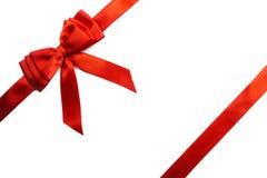 Shiny red satin ribbon on white background stock image