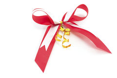 Shiny red satin ribbon. On white background Stock Image