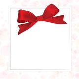 Shiny red satin ribbon. On white background Royalty Free Stock Photos
