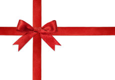 Shiny red satin ribbon on white Stock Photo