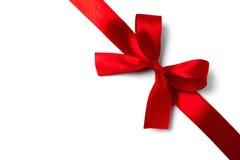 Shiny red satin ribbon on white background royalty free stock photography