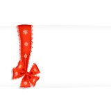 Shiny red satin ribbon on white. Openwork festive red ribbon with white snowflakes. Red volumetric photo-realistic bow. White sheet and place for greetings with Royalty Free Stock Photo