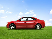 Shiny Red Sedan In The Outdoors Royalty Free Stock Photos