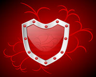 Shiny Red Shield with Swirls Stock Photography