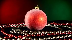 Shiny red toy for Christmas or New Year and beads stock footage