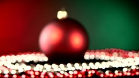 Shiny red toy for Christmas or New Year and beads. Shiny red toy for Christmas tree for decoration Christmas or New Year and red and white beads, rotation, on stock video footage
