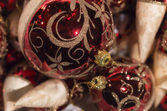 Shiny red and white christmas tree balls with golden ornament Stock Image