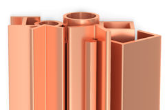 Shiny rolled copper metal products. Metallurgical industry non-ferrous industrial products - group of stainless rolled copper metal products profiles, pipes Royalty Free Stock Image