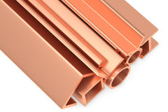 Shiny rolled copper metal products on white closeup. Metallurgical industry non-ferrous industrial products - group of stainless rolled copper metal products Stock Photography