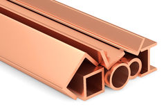 Shiny rolled copper metal products on white. Royalty Free Stock Images