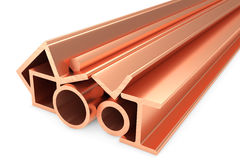Shiny rolled copper metal products on white. Metallurgical industry non-ferrous industrial products - group of stainless rolled copper metal products pipes Stock Image