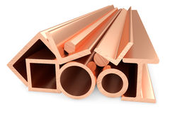 Shiny rolled copper metal products on white. Stock Photos