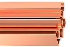 Shiny rolled copper products on white. Metallurgical industry non-ferrous industrial products - stainless rolled copper products pipes, profiles, girders, bars Royalty Free Stock Photos
