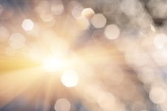Shiny romantic bokeh. Defocused spots of water drops and lens flare or flash.  Stock Images