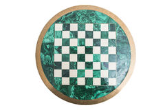 Shiny round green stone empty chess board on isolated background. Royalty Free Stock Photography