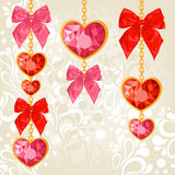 Shiny ruby heart pendants hanging Stock Images