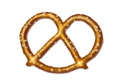 Shiny salted pretzel. Single salted baked pretzel on white background Stock Images