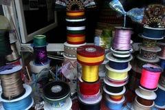 Shiny satin ribbons at traditional notions store Royalty Free Stock Image