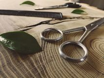 Shiny scissors on wooden background stock images