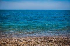 Shiny sea coast with shingle Stock Image