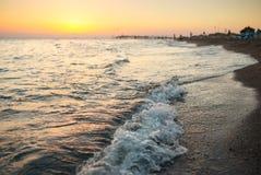 Shiny sea waves on the beach Stock Image