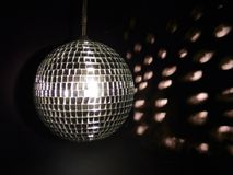 Shiny shiny disco. Ball with reflected light at background royalty free stock images