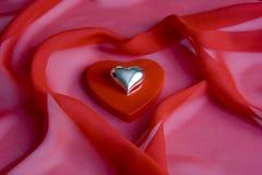 Shiny shiny heart on a small box as a heart royalty free stock photography