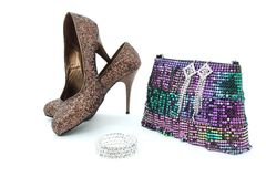 Shiny shoes, bracelet, earings and bag Royalty Free Stock Photography