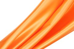 Shiny silk orange drapery. Stock Image