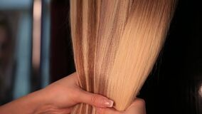 Shiny silky blonde hair extensions closeup