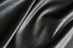Shiny, silky and smooth surface of black fabric stock images