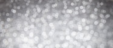 Shiny silver abstract bokeh background Stock Photography